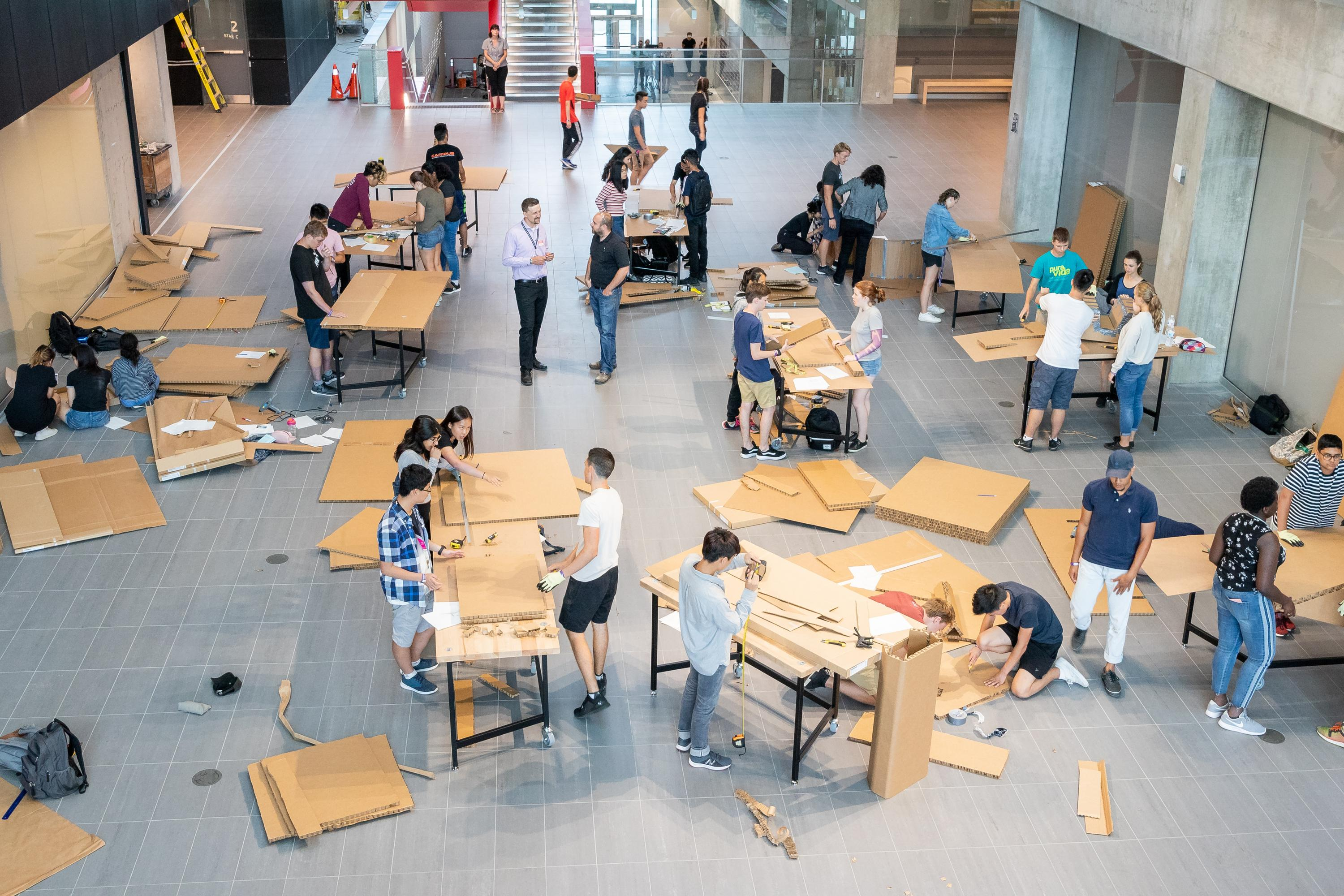 Students working on furniture designs