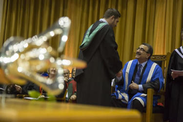 Convocation scene with mace