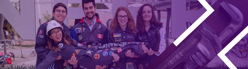 Five engineering students wearing coveralls.