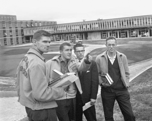 Four young men front of the 'Chemical Engineering' bulding, now called Douglas Wright Engineering