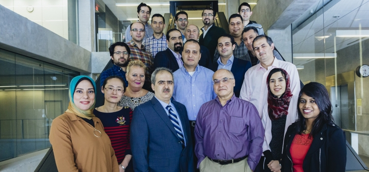 Group photo of Ali Safavi-Naeini and team of researchers