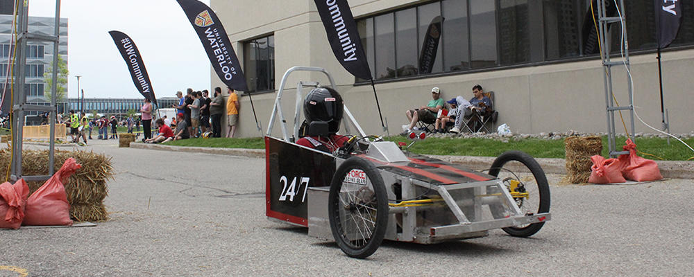 Student in EV Challenge Vehicle on UWaterloo Campus
