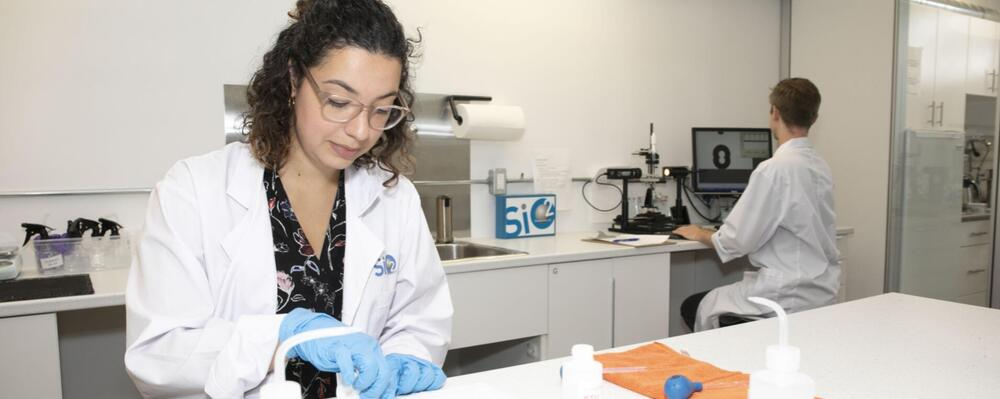 A researcher works in a lab.