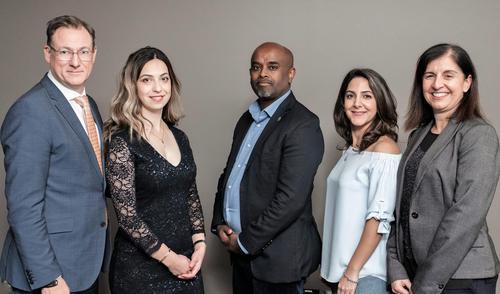 Hydro One representatives (left to right) Greg Lane, Sara Aslanbeigi, Temesghen Bzauayehu, Bahareh Tehrani and Vivian Yoanidis pose together at the 2019 Awards Dinner.
