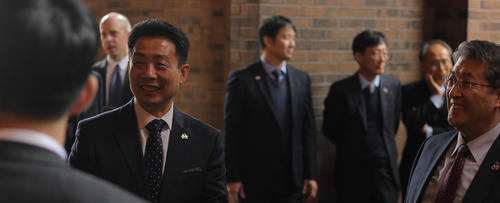HJ Kwon, a professor at Waterloo Engineering, socializes with dignitaries at a signing ceremony for the start of a research collaboration with South Korea.