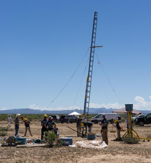 Members of a Waterloo Engineering student design team prepare to launch their new rocket, Unexploded Ordinance (UXO), during a recent competition in New Mexico, where they finished first in their category.