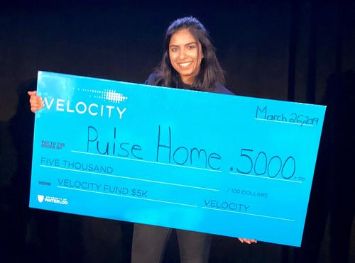 Emman Haider of Pulse Home poses with a ceremonial cheque at the recent Velocity Fund Finals.