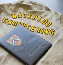 Waterloo Engineering jacket and yearbook