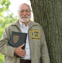 Bill Lennox (BASc '62) wearing Waterloo Engineering jacket and holding yearbook