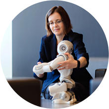 Dana Kulic with a robot