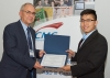 Yunzhe Li receives his TEXPO award from Guy Hamel.