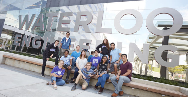 students sitting in front of E7 Waterloo Engineering sign
