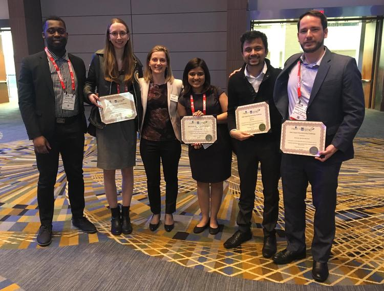 Graduate students (left to right) Ken Nsiempba, Lisa Brock, Gitanjali Shanbhag, Sagar Patel and Alex Martinez pose at the recent awards event with Mihaela Vlasea (third from left), a professor and assistant research director at the MSAM Lab.