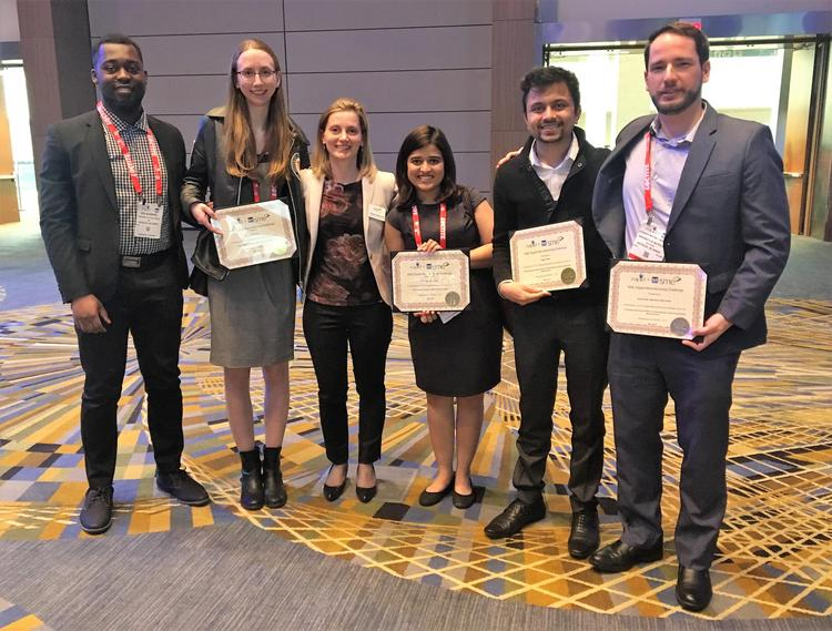 Graduate students (left to right) Ken Nsiempba, Lisa Brock, Gitanjali Shanbhag, Sagar Patel and Alex Martinez pose at the recent awards event with Mihaela Vlasea (third from left), a professor and associate research director at the MSAM Lab.