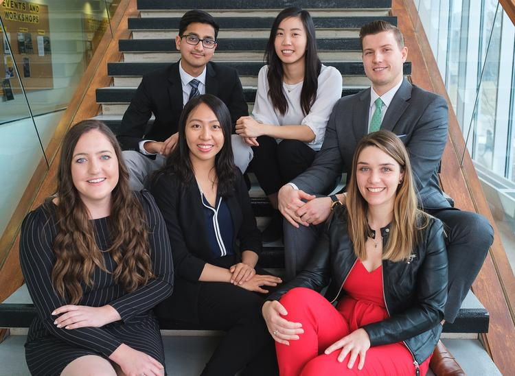 Nathan Duarte of Waterloo Engineering poses with top co-op students from the other five faculties.