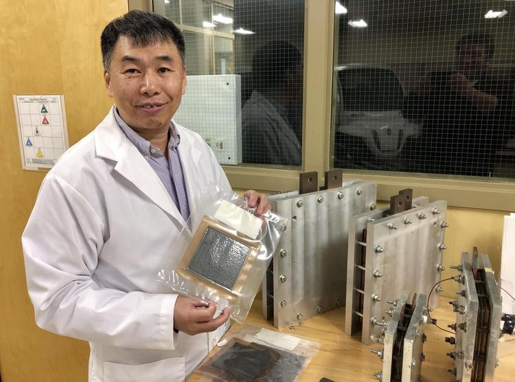 Waterloo Engineering professor Xianguo Li displays a fuel cell in his lab.