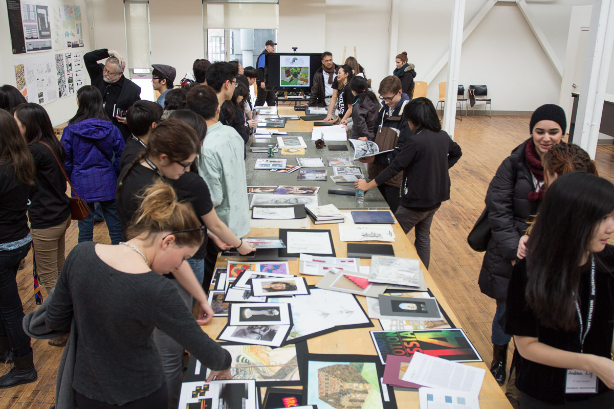 Architecture students displaying portfolios