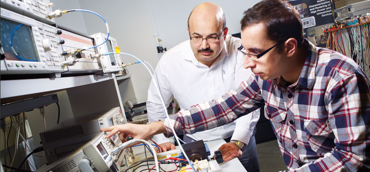 Electrical and computer engineering professor Slim Boumaiza with fellow researcher in a University of Waterloo lab