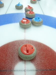 curling on sheet of ice
