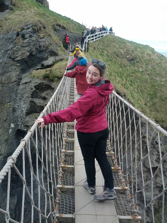 Student crossing a suspension bridge in Northern Ireland