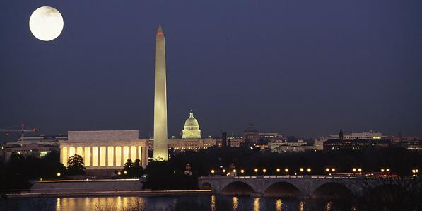 Washington DC skyline at night with full moon
