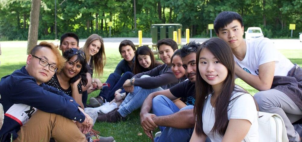 Students sitting together outside