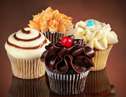 Picture of 4 decorated cupcakes.