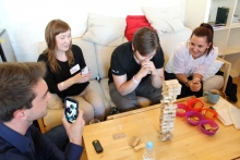 Friends playing Jenga.