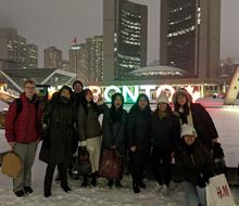 Students in front of the Toronto sign at Nathan Philip Square