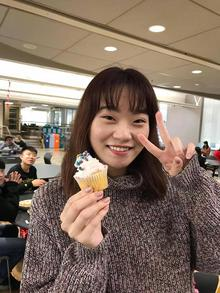Crystal Liu with a cupcake