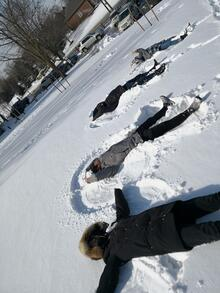 people doing snow angels