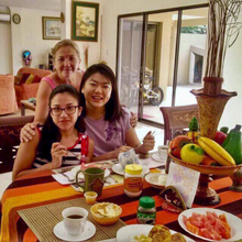 Daniela, Daniela's mother, and Yifei eating breakfast at Daniela's home in Ecuador