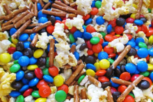 popcorn mixed with pretzels and chocolate candies