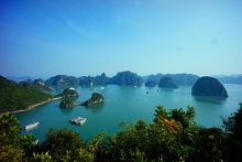 Vietnam's Halong Bay with two ships in a sheltered cove