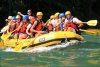 Friends on a rafting boat.