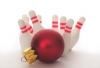Christmas ornament knocking over bowling pins