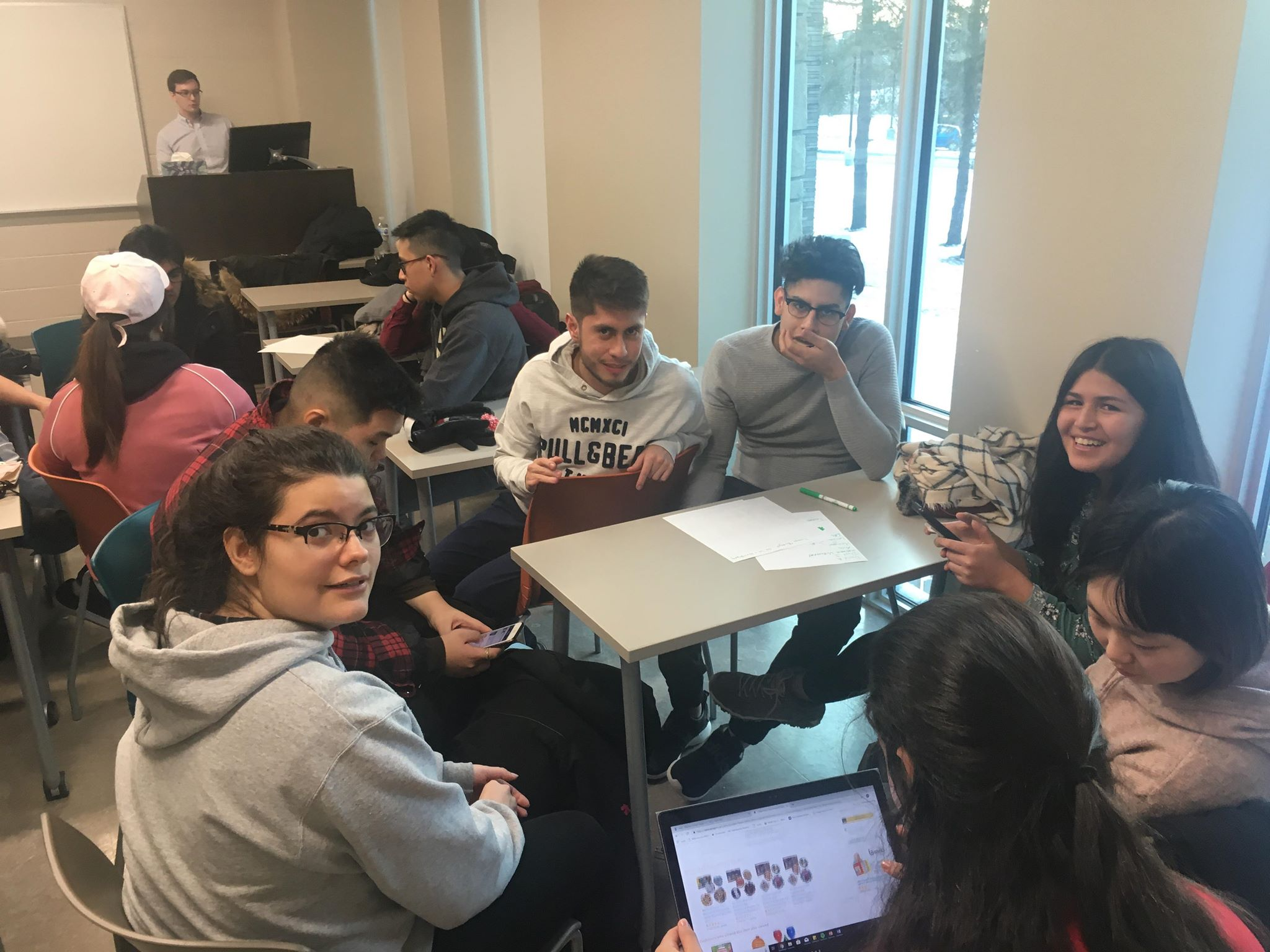 Students working together in BASE rep meeting.