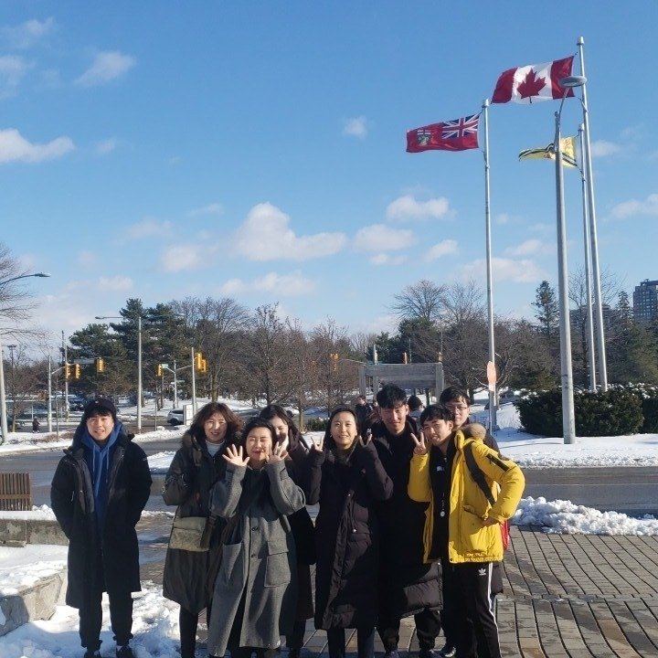 Group picture in front of the Canadian flag