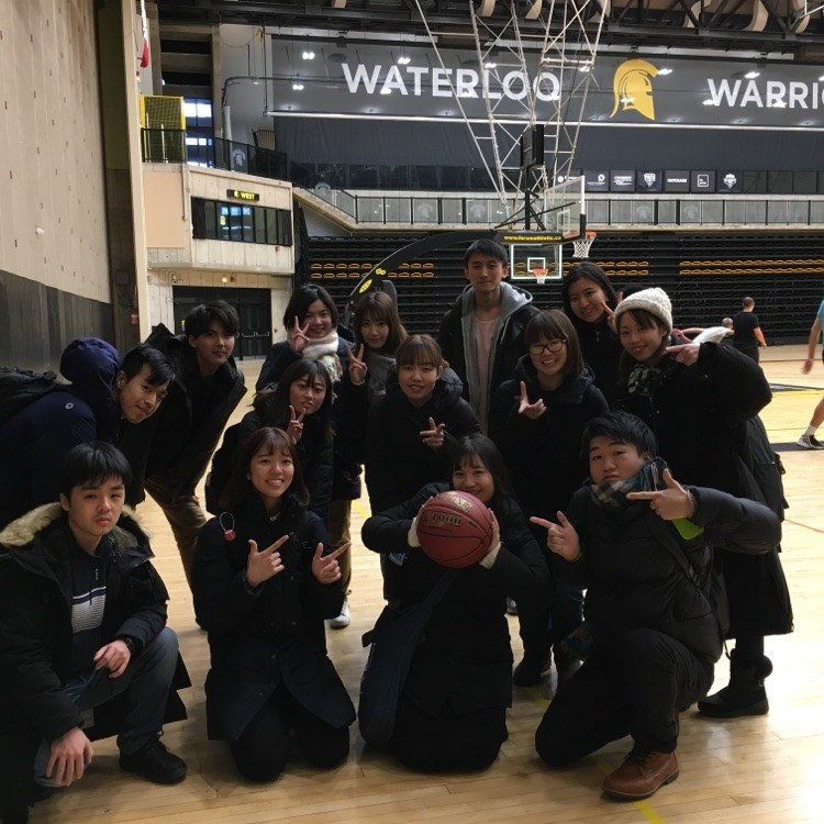 Students at PAC gym, one of the student is holding a basketball