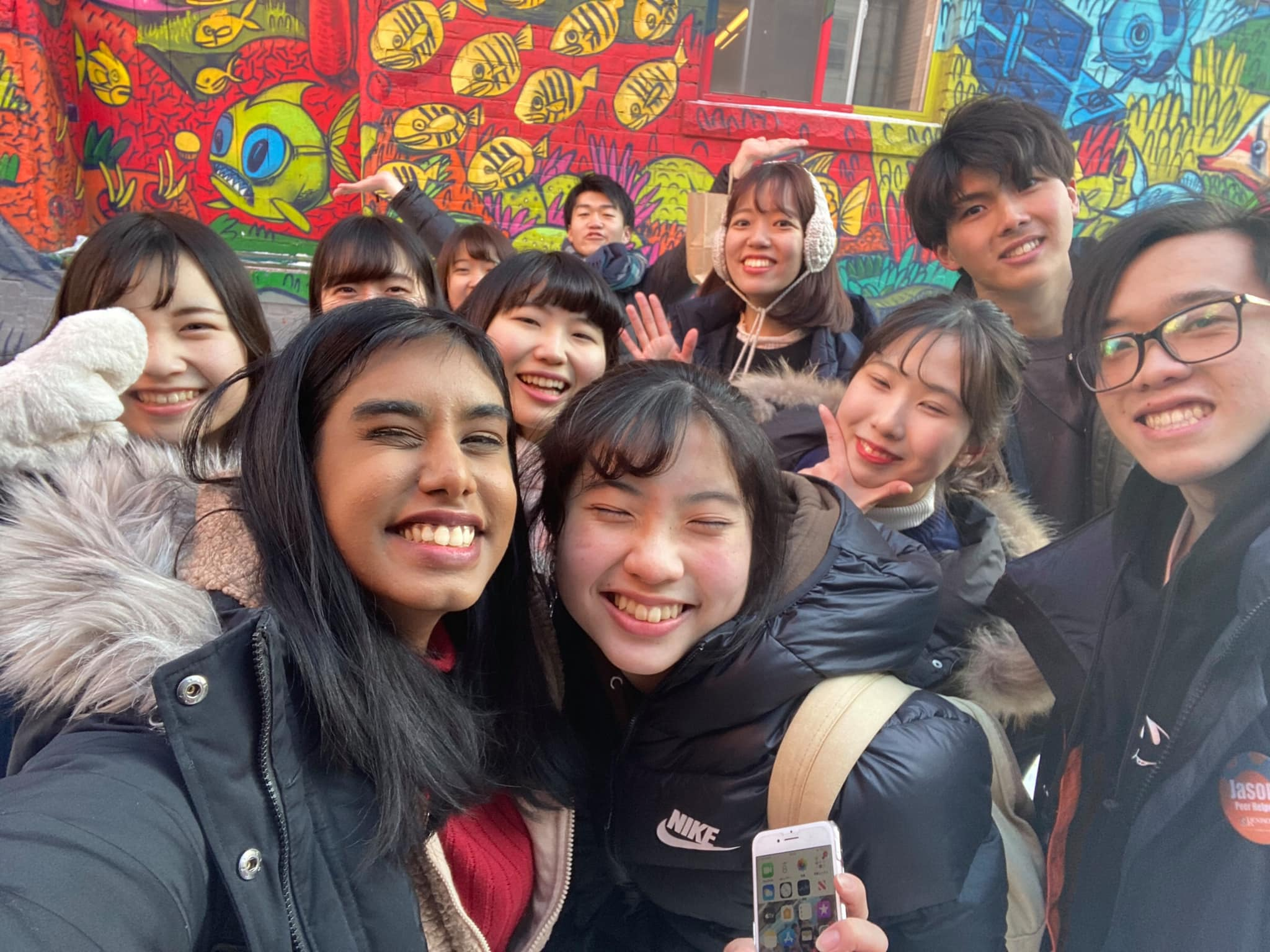 GEAR Students took a selfie in front of the graffiti wall
