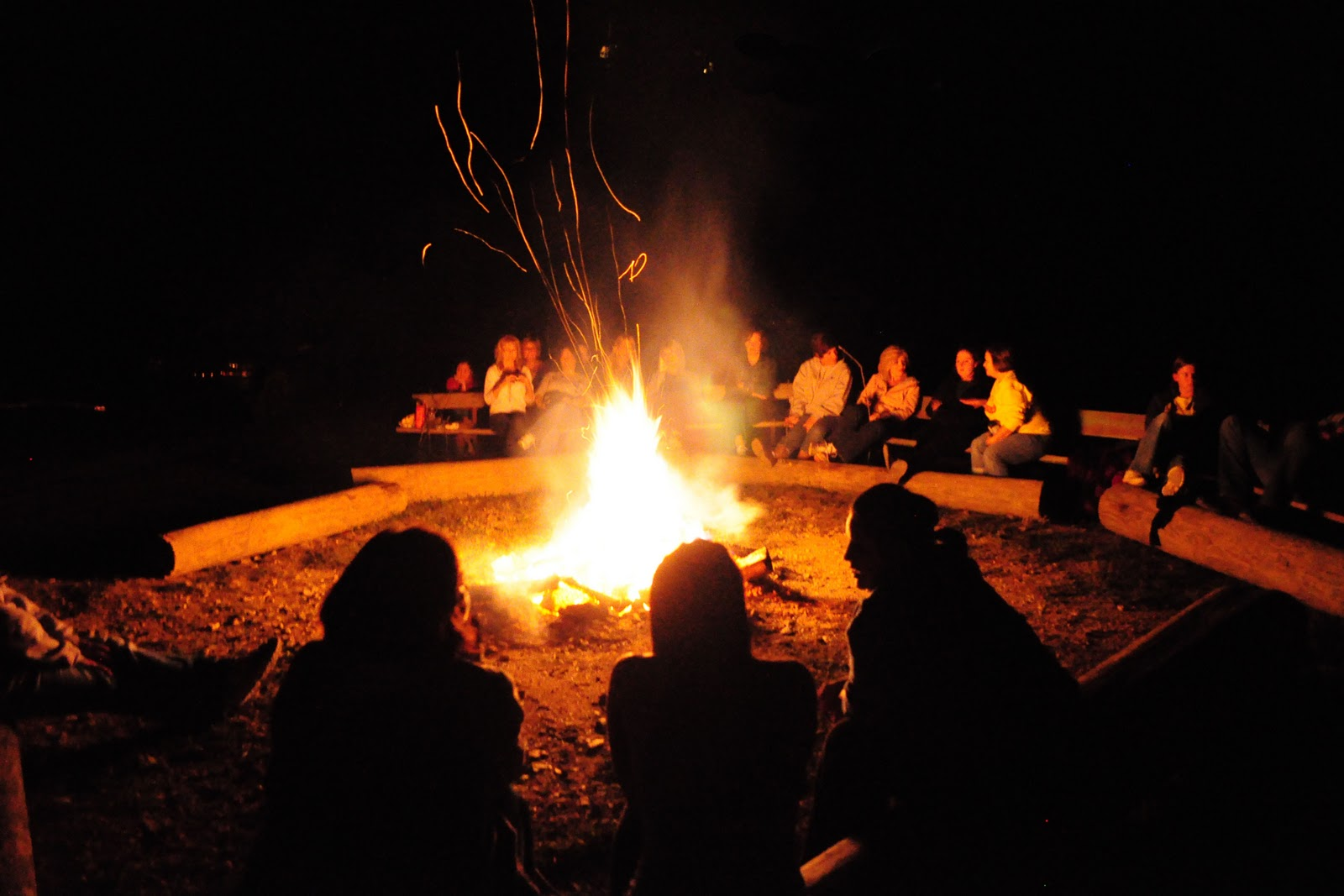 People sitting around a bonfire.