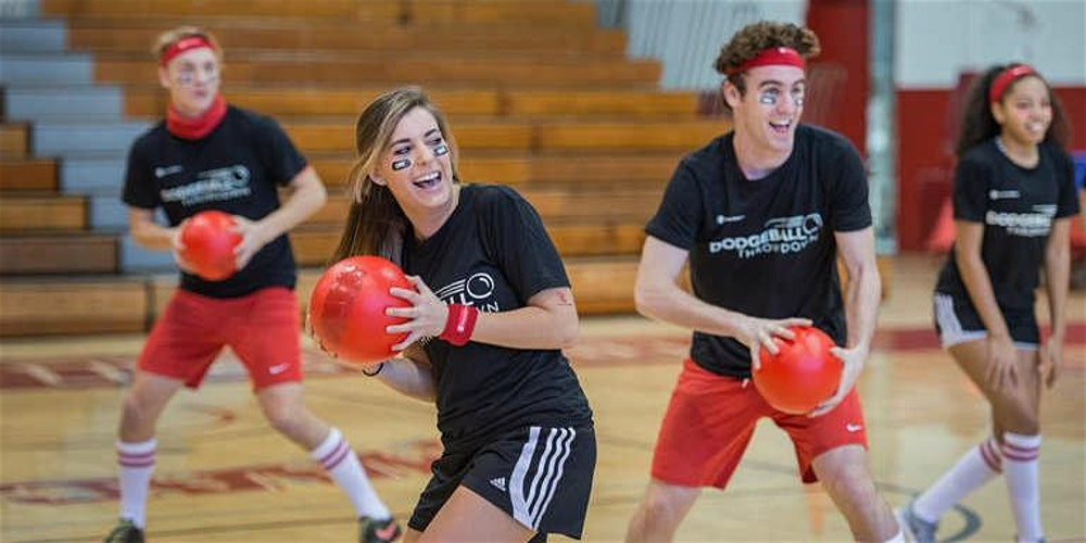 Friends playing dodgeball together. Three out of the four are holding a red ball in their hands