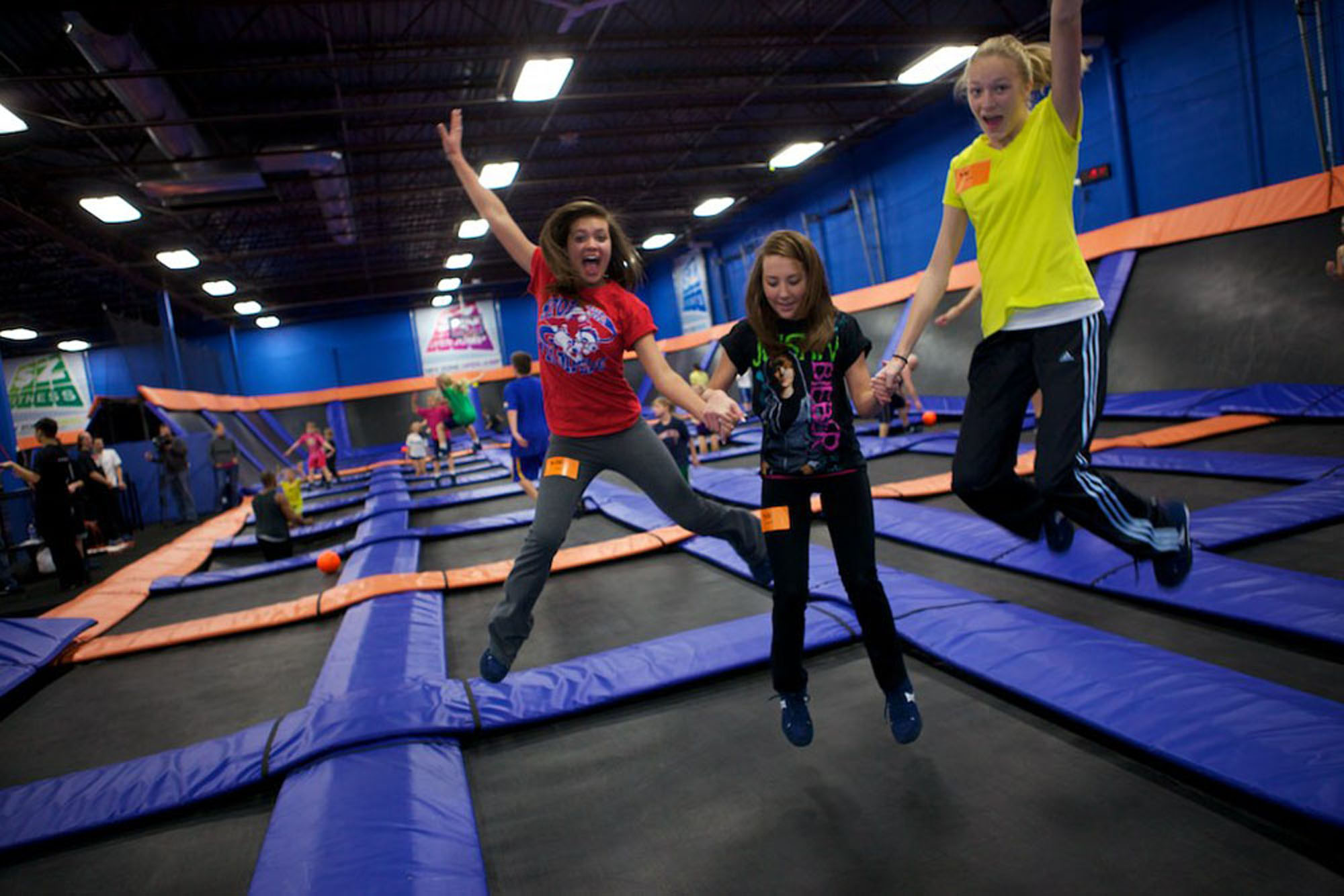 People jumping on trampolines.