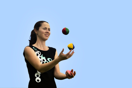 Woman juggling three balls.