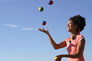 Women juggling balls