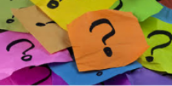Photo of coloured post-it notes with question marks.