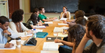 Photo of students around a seminar table.