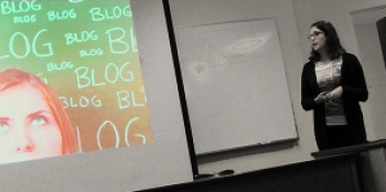 Photo of student giving presentation on a blog.
