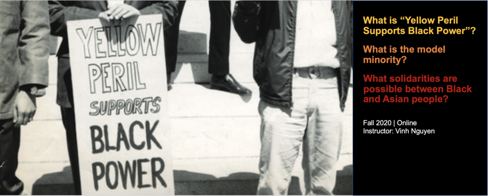 "Photo of men at demonstration holding a ""Yellow peril supports Black power"" sign."