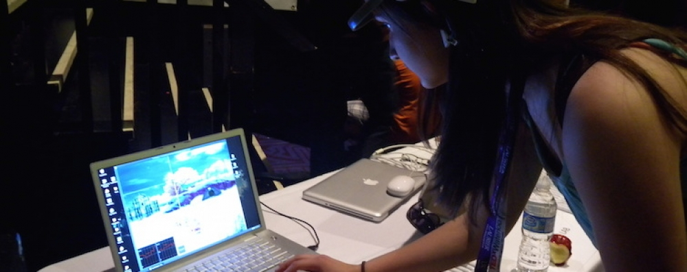 Woman with laptop and mindwave equipment